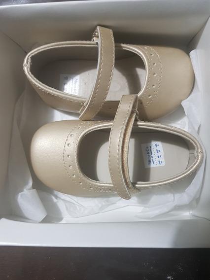 Zapatos Guillermina, Bautismo.