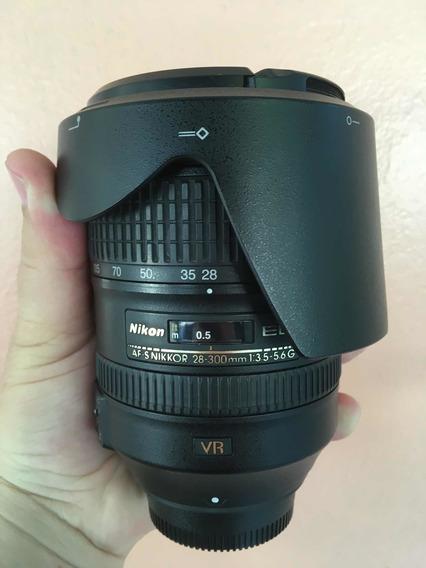 Lente Nikon 28-300mm 3.5-5.6g Vr - Baixei Pra Vender Logo
