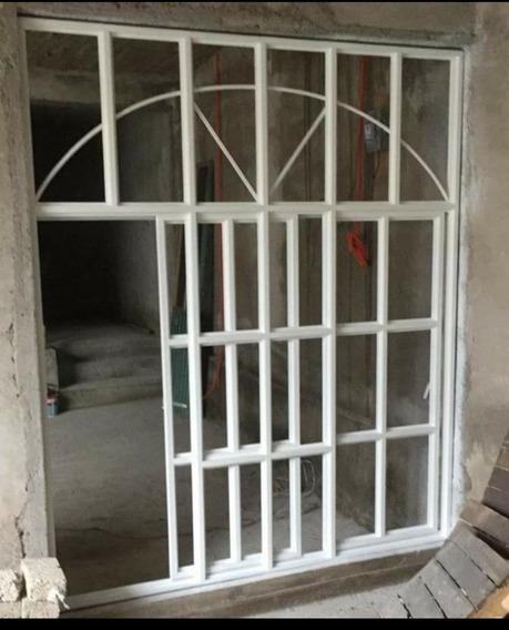Ventanal Y Puerta De Herreria