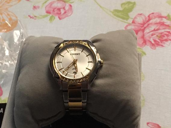 Relógio Orient Dourado Com Prata Semi Novo Sem Detalhes.