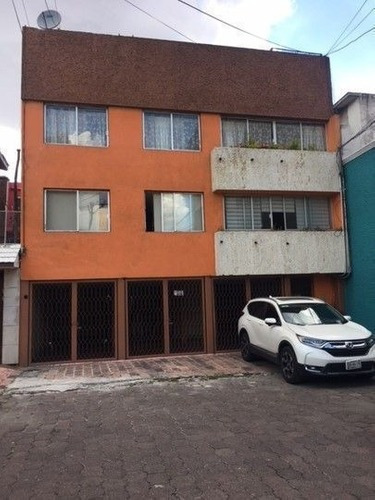 Edificio Con Departamentos Y Locales Comerciales