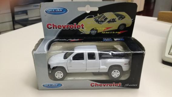 Chevrolet Silverado 99 Welly Escala 1:32 (49759)