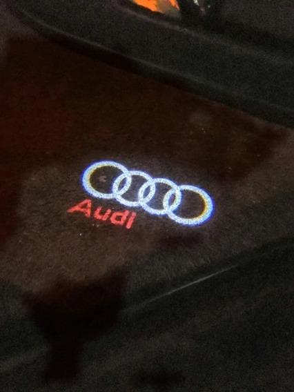 Projetor Led Logo Audi Luzes Cortesia Portas Emblema Argolas
