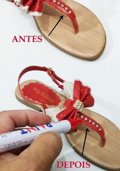Caneta Vermelha De Retoque Em Riscos De Sapatos-tenis-botas