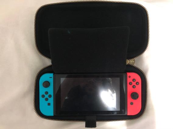 Nintendo Switch Neo + Case Deluxe + Jogo - (usado)