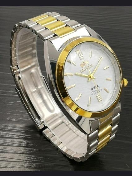 Relógio Orient Quartz Unissex Prata C/dourado Fundo Branco