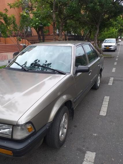 Mazda 323 Automovil Modelo 1990 1996