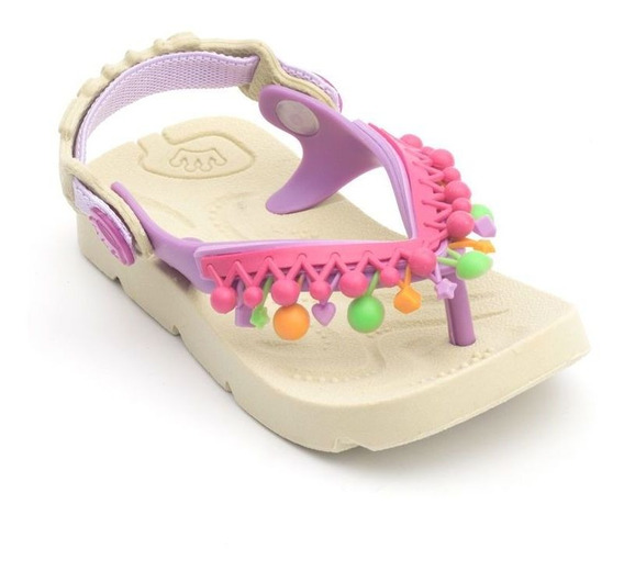 Chinelo Plugt Beach Pompom Franja Infantil - Creme/lilás