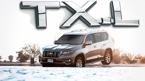 Emblema Txl Toyota Prado