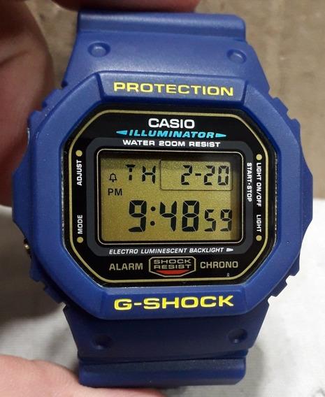 Relógio Casio G-shock Dw 5600 Eg Série Ouro C/ Roupagem Azul