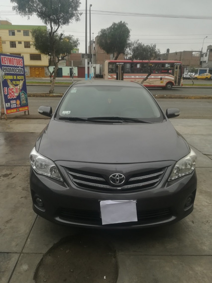 Toyota Corolla/2012 - Gris Oscuro Metalico - Dual Gli 1.6 A