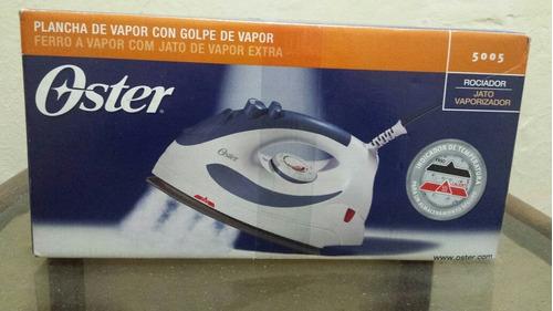 Imagen 1 de 3 de Plancha Oster A Vapor Con Rociador Modelo 5005