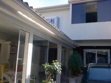 Casa Em Cavalhada Com 3 Dormitórios - Mi11404