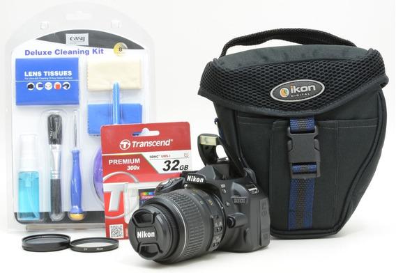 Nikon D3100 + 18-55mm + Brindes