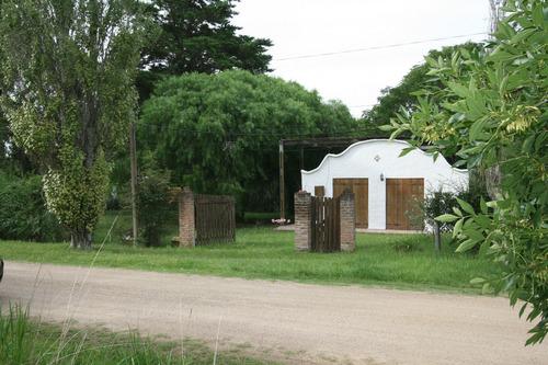 Un Lindo Predio Con Una Casa Con Dos Dormitorios