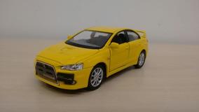 Miniatura Mitsubishi Lancer Evolution X Amarelo