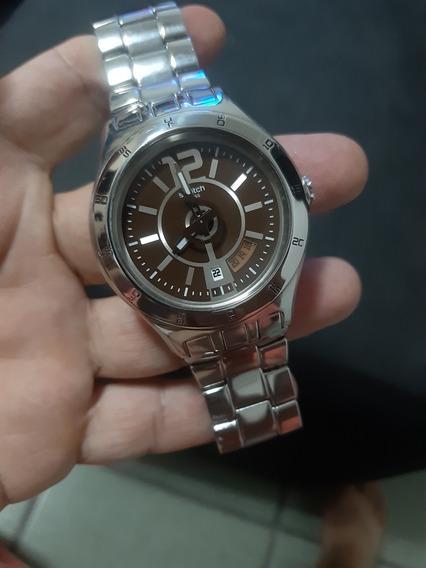 Relógio Swatch Modelo Novo Data Fundo Marrom Em Aço.