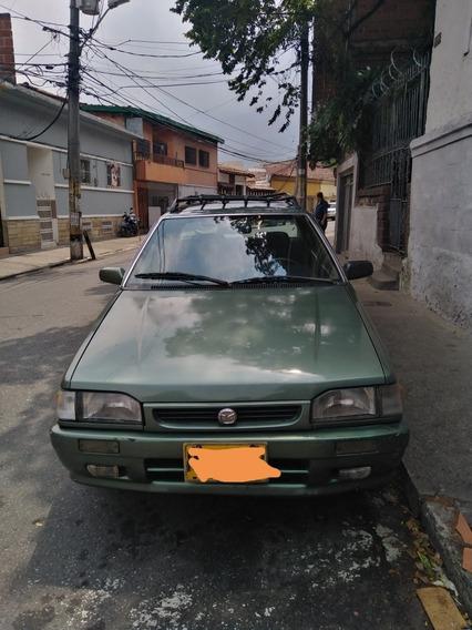 Mazda 323 Con Maleta