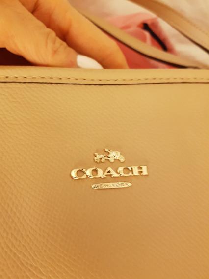 Cartera Coach