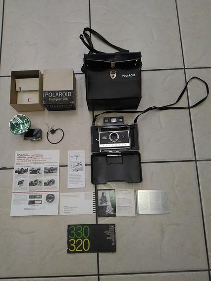 Camera Polaroid 330 C/ Acessorios Usada E No Estado