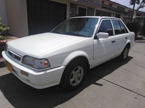Mazda 323 Nei 1300, Blanco Orion, 4 Puertas, Año 2002