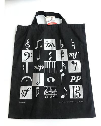 Imagen 1 de 2 de Bolsa Negra Con Plateado (notas Musicales)