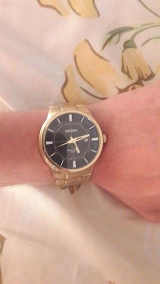 Relógio Dourado Orient