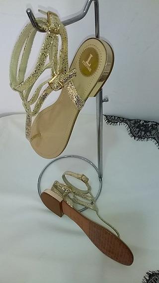 Sandália Dourada Lança Perfume