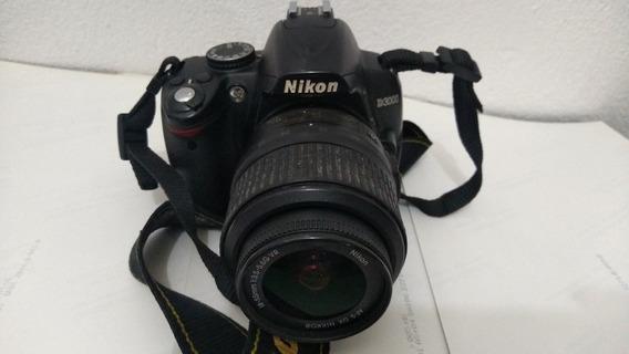 Câmera Nikon D3000 Com Lente 18~55mm Mais Bateria E Carregan