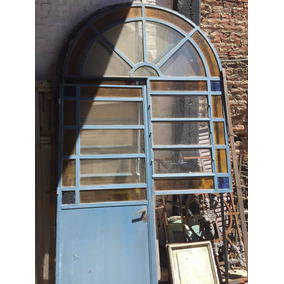 Puerta De Hierro Antigua Con Ventana Y Medio Punto