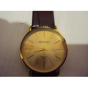 Hermoso Reloj Mingbo Color Oro Extensible De Piel Cuarzo