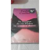 Livro Na Margem Do Rio Piedra Eu Sentei E Chorei