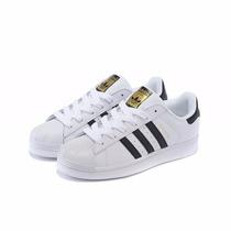 zapatillas adidas blancas con franjas negras