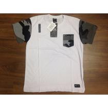 Camiseta Oakley Com Bolso Camuflado Original Mcd Quiksilver