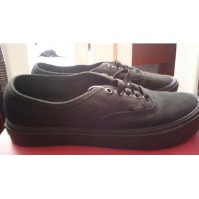 vans negras zapatillas suela marron
