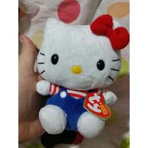 Hello Kitty De Pelúcia Com Jardineira Azul Coleção Sanrio Ty