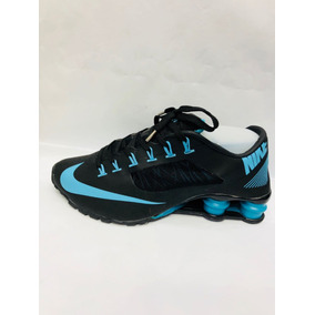 60a4269e6f new style nike shox 4 molas preto e azul de1c1 960bf