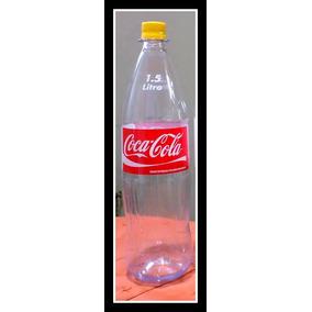Cajón Con 12 Envases Vacíos De Coca-cola De Plástico 1,5 L.