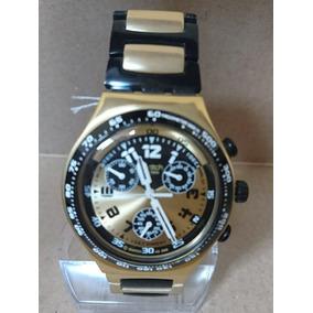 Relógio Swatch Ycg4000ag Dourado E Preto.