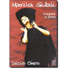 Marika Gidali-singular E Plural