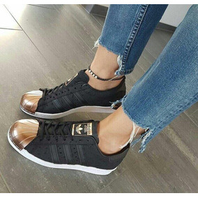 zapatillas adidas negras y doradas mujer