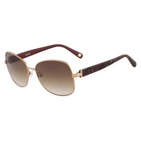 b1f0461379466 Óculos De Sol Nine West Nw116s 780 58 Dourado Rosa por Compre Oculos