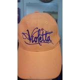 Gorra Violetta Disney. Color Naranja Foforesente. Ajustable