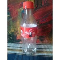Coca-cola Envase Plástico. Banda Nueva. 250ml. Vacía