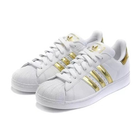 zapatillas adidas blancas y doradas