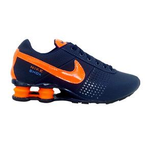 official photos 2d7fd 61b56 ... Tênis Nike Shox Deliver Azul Marinho E Laranja ...