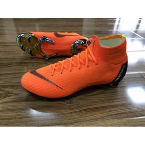 Chuteira Nike Mercurial Vermelha Cano Alto - Chuteiras Nike de Campo ... b1edde0d5608c