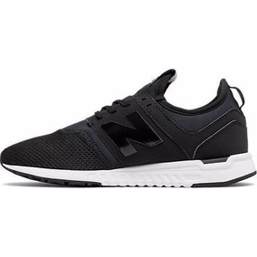 new balance negras blancas