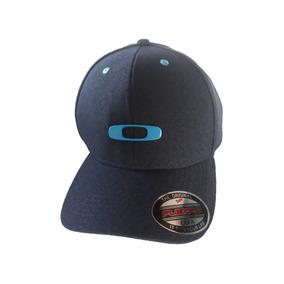 Boné Oakley Tincan Flexfit Azul Aba Curva Simbolo De Ferro 59ad9c28a0c