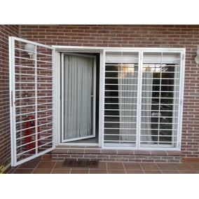 Puertas patio o balcon hogar seguridad rejas y redes for Puertas para patio exterior